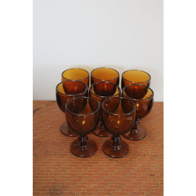 Set of 8 amber colored glass chalices. Very sturdy and thick glass.