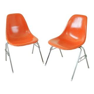 Herman Miller/Eames Mid-Century Modern Orange Shell Chairs - a Pair