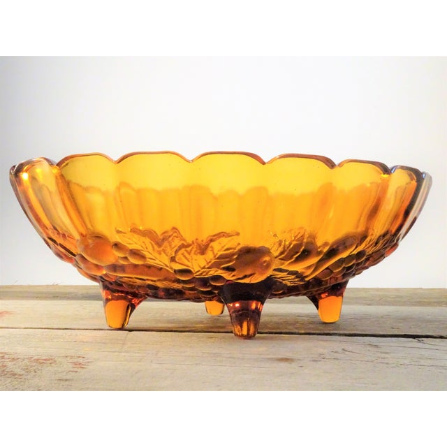 This bowl will be perfect to decorate in the season of rich fall colors. This vintage pressed glass, deep golden amber...