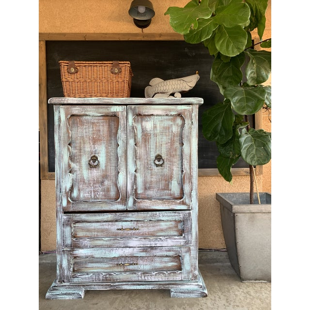 This is a unique hand painted dresser with rustic looks. The dresser is solid wood.