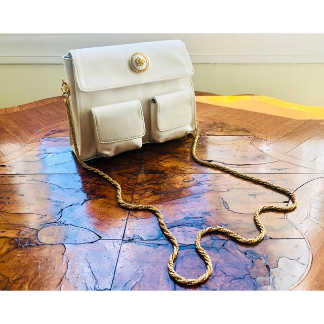 Rare find: Authentic Gianni Versace Medusa purse from the 1980s. Fantastic gold hardware. Bright white silk. Never used....