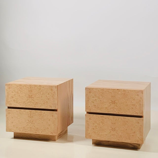 Pair of minimalist 'Amboine' burl wood nightstands by Design Frères. Simple, functional design with 2 deep drawers per...