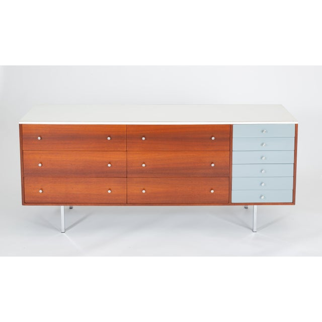 A late 1950s custom-built dresser by California designer and craftsman Gerald McCabe has a walnut body with a white...