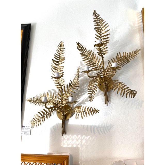 This stylish and chic pair of wall scones with their gold finished fern fronds will make a definite statement. Each...
