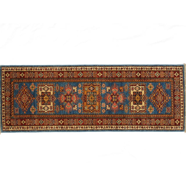 This master piece is a Ghazni wool pile very fine genuine hand woven vegetable dye Super Kazak in mint condition.