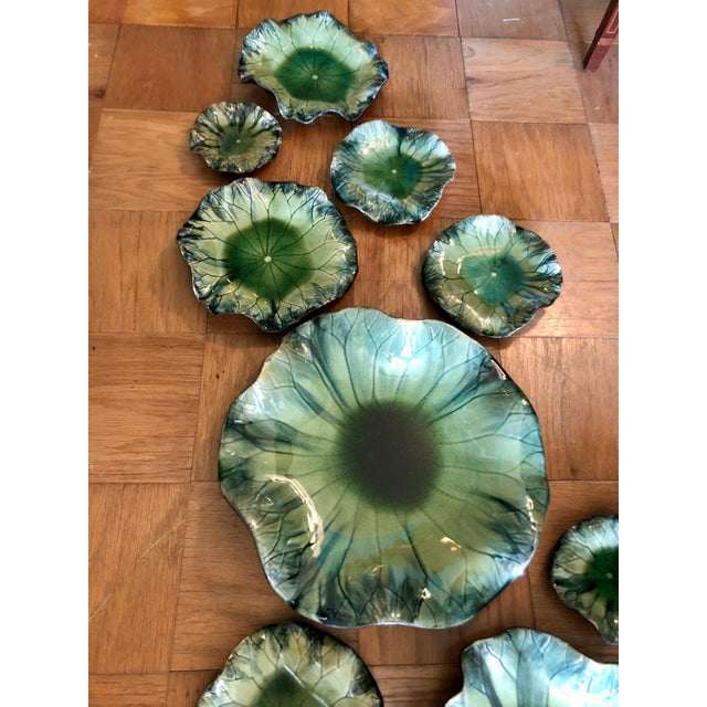 Incredible large scale glazed ceramic lily pad wall sculpture by Global Views. Pads can be placed in whatever...
