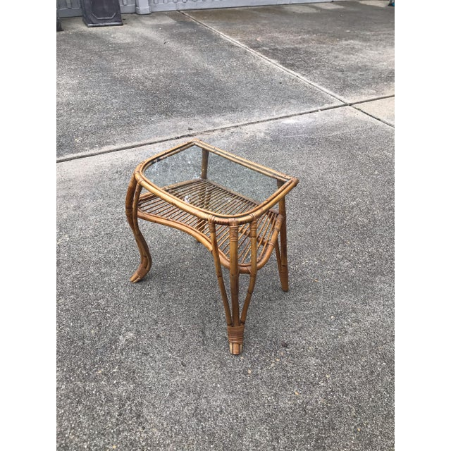 Glass top rattan and bamboo mid century side table. Made in the mid 20th century.