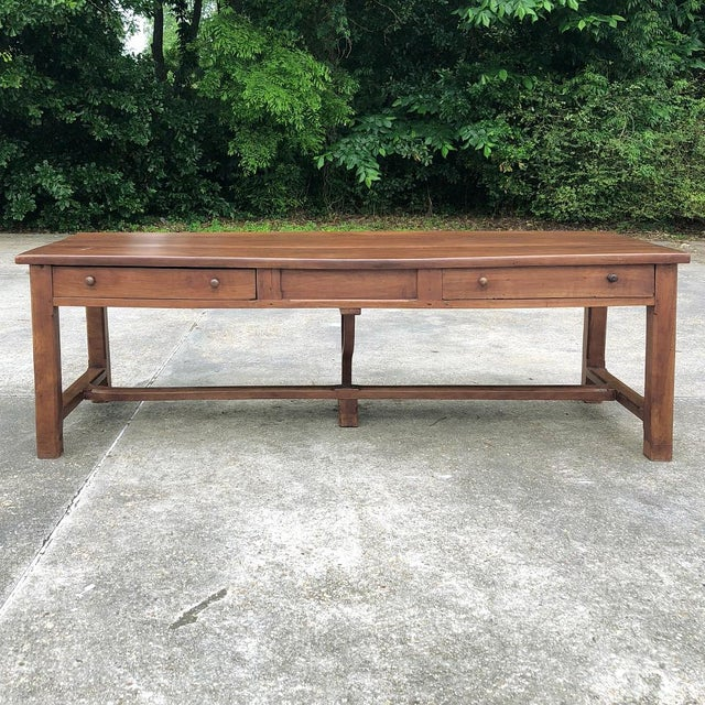 Hand-crafted by talented rural artisans from locally grown solid cherry wood, this handsome 19th Century French Cherrywood...