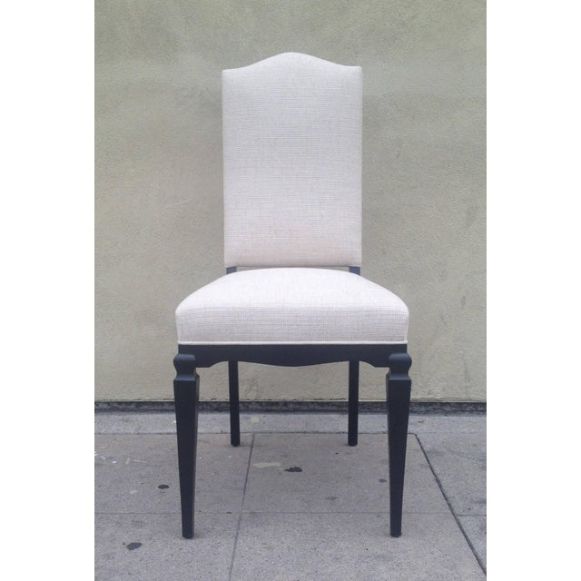 This set of elegant finding chairs features a clean ebonized wood frame and white-beige tweed upholstery. Perfect for your...