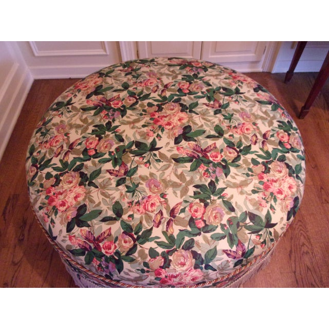 Large round ottoman custom upholstered in a hand screen fabric named Churchill., based on the English Prime Minister's...