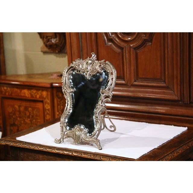 Elegant antique dressing mirror from France; crafted circa 1870, the freestanding table mirror features the original...