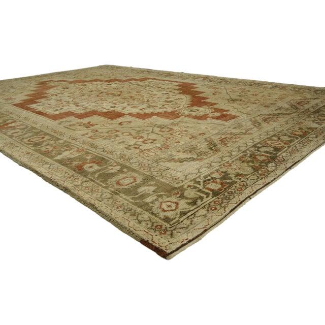 Modern Rustic Vintage Turkish Oushak Rug, 06'04 x 09'03. This vintage Turkish Oushak rug with modern style features a...