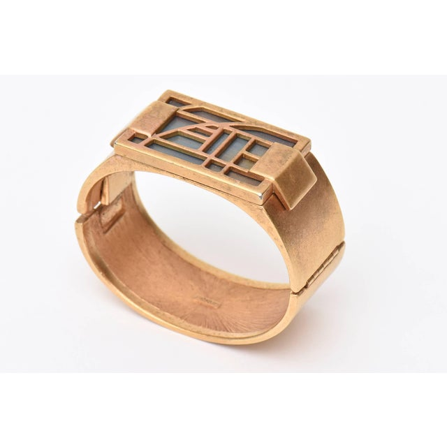 This Stunning and artistic Monet gold plated hinged cuff bracelet is like a studio piece that has stained glass like resin...