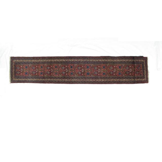 Handmade antique Persian Tabriz runner featuring a plush wool pile. Measures 2′4″ × 13′8″.