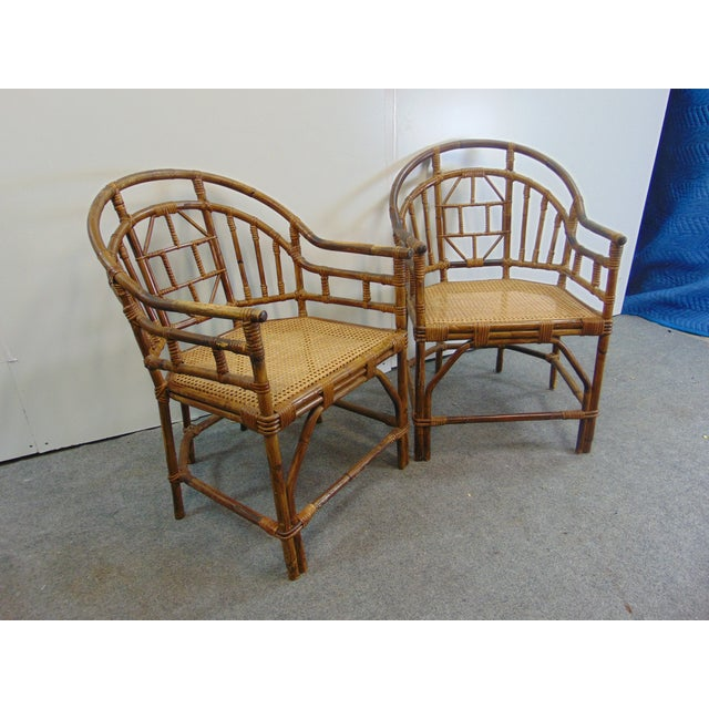 A pair of Mid Century Chinoiserie Bamboo Chairs with cane seats