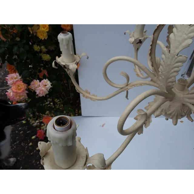 Classic 80's Scrolling Iron Chandelier With off white hand painted finish. This was holes for Crystals if you want to...
