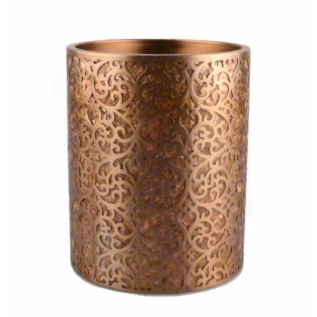 Decorative capiz shell and metal wastebasket, no markings.