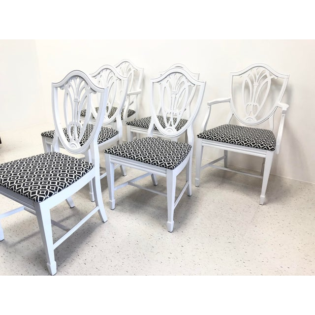 Set of six Chippendale style dining chairs lacquered in white satin. Two arm chairs and four armless dining chairs....