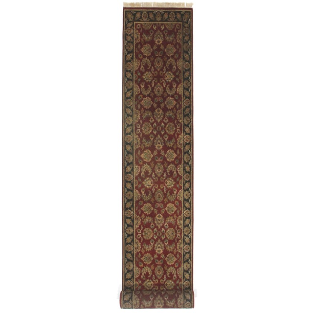 Persian style hand knotted wool runner. Rich burgundy background, black border and multi color all over designs. Measures...