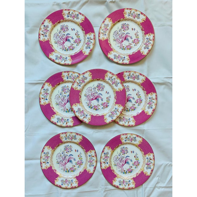 Offered is this stylish antique Minton Cockatrice Pink plates featuring bold pattern of bright pink with a central...