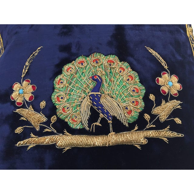 Velvet midnight blue silk pillow hand embroidered with gold threads and sequins depicting a royal peacock on a branch....