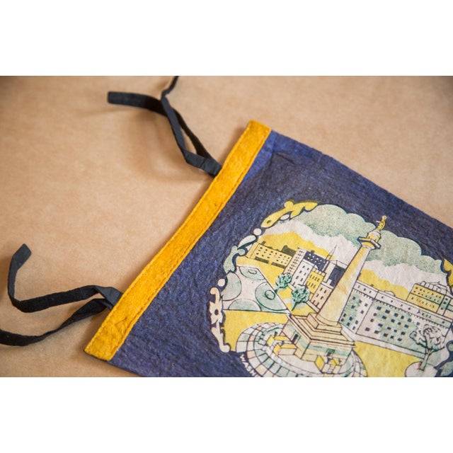 :: Baltimore Maryland felt flag with lightly colored imagery of the Washington Monument, circa 1960s vintage. This pennant...