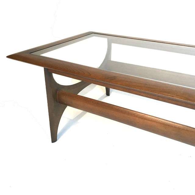 Sculptural Classic Midcentury design. Walnut framed table with a glass insert. Beautiful piece in excellent condition. *we...