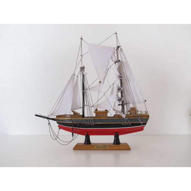 Wooden ship model of the fishing and racing schooner Blue Nose, popular in the 1930s. Sails and masts are moveable. Small...
