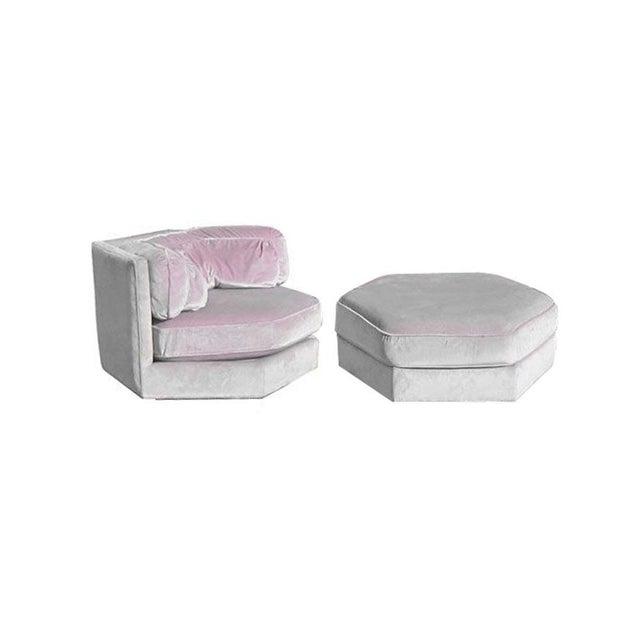 One velvet hexagonal light lavender lounge chair with ottoman. Upholstered in light lavender/pink shimmering velvet, by...