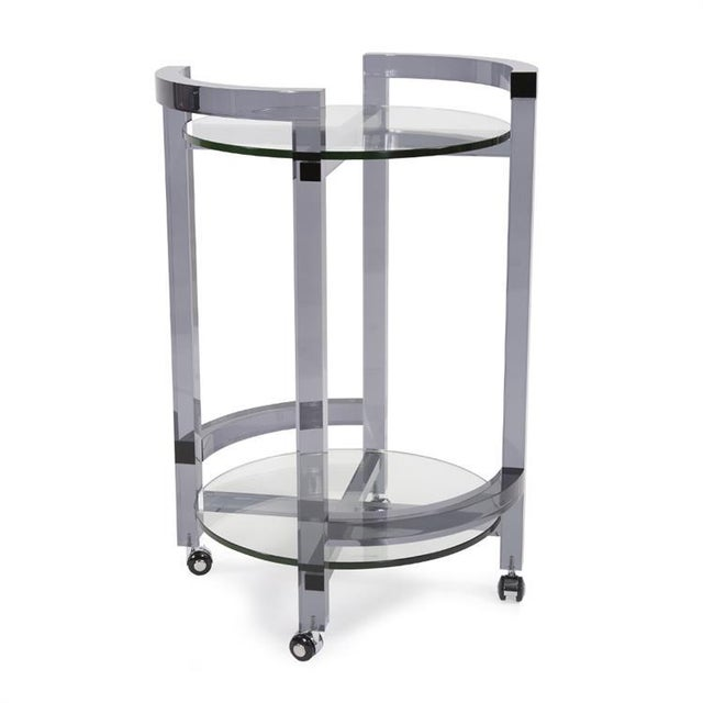 As rich as the bubbly you would serve, this smoked acrylic rolling bar cart is the epitome of form and function. The frame...