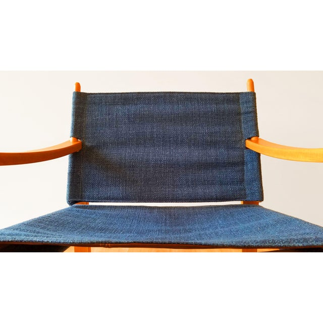 Vintage safari sling chairs. Sling seat is supported by leather-strapped underside. Excellent vintage condition.