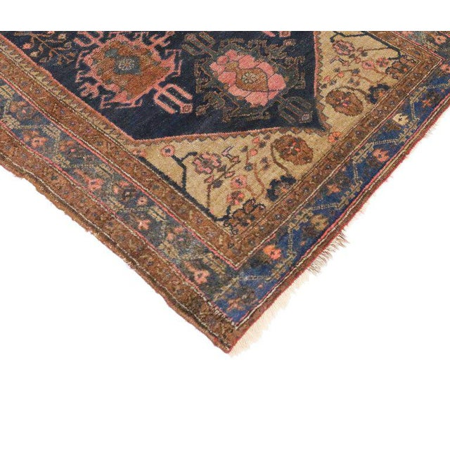 Full of character and stately presence, this antique Hamadan Persian rug with modern style showcases an extravagant...