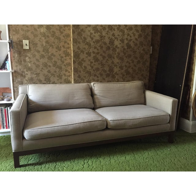 Sofa #2 floor model in Holland & Sherry Palpana Gris linen comes standard with down and feather seat and back cushions....