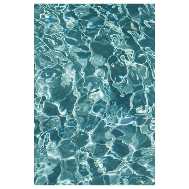 This series of photographs captures the play of light, texture, and pattern in the abstract surfaces of a pool in Miami...