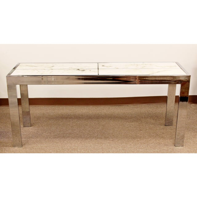 For your consideration is a magnificent, chrome console table, with white marble top inserts, designed by Milo Baughman,...
