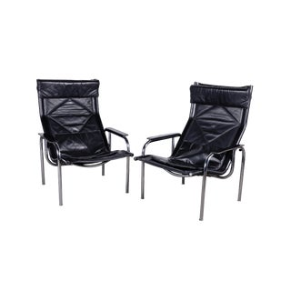 1960s Swiss Reclining Black Leather and Chrome Strässle Chairs by Eichenberger - a Pair For Sale