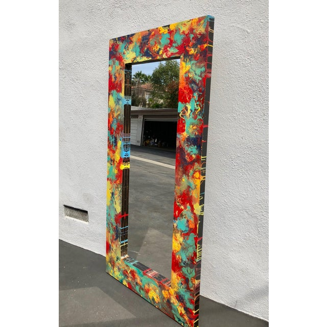 This large floor length mirror is both a functional mirror and an abstract art work at the same time! This mirror features...