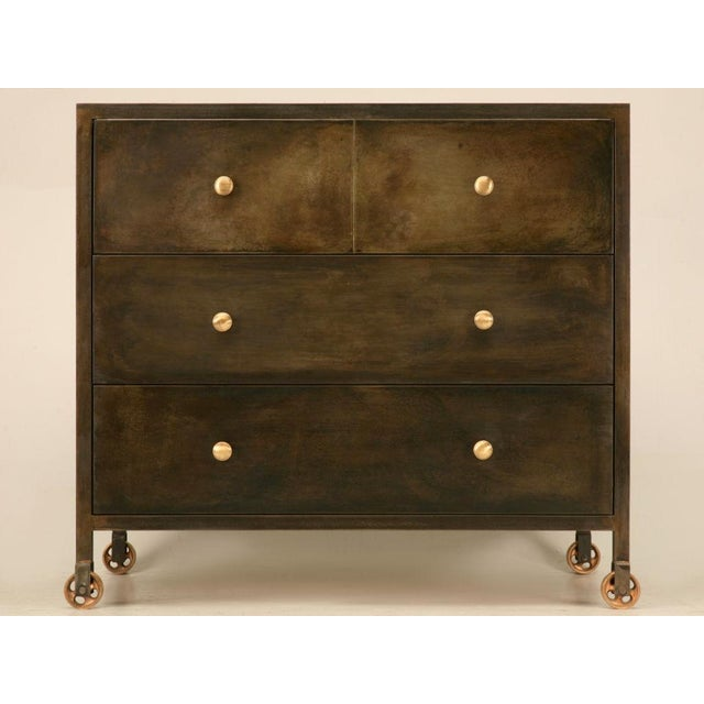 """Stunning steel commode, or chest of drawers made to house a sink if you desire. Notice how the middle drawer has a """"U""""..."""