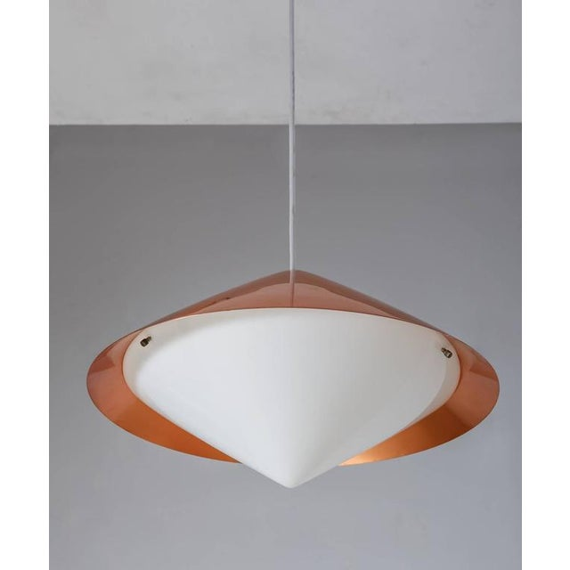 A model 61-343 or 'Kuli' pendant lamp, designed by Svea Winkler for Orno. The lamp is made of a red lacquered metal shade...