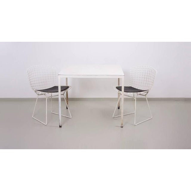 Nice small dining set by Knoll in white, white with vintage chair pads.