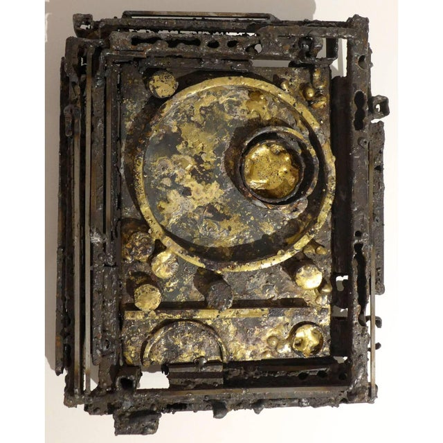 Rectangular and dimensional wall sculpture of gilded, blackened, and textured steel by Des Moines, Iowa, artist James...