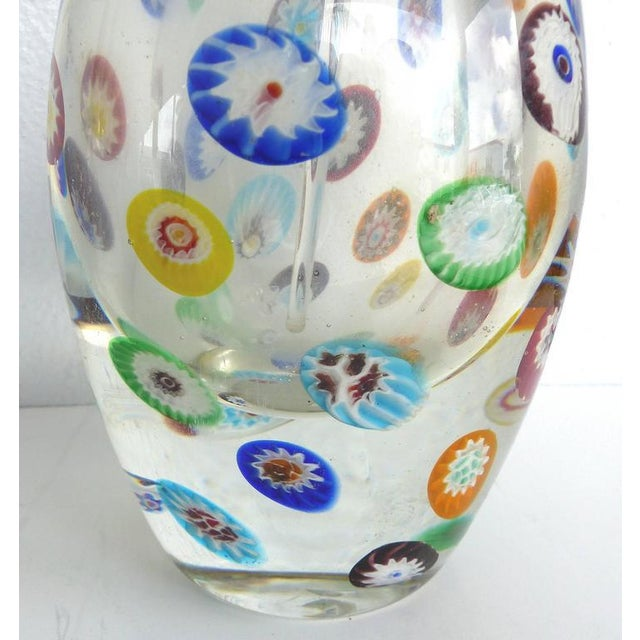 A large Murano Gambaro & Poggi colored Millefiori glass scent bottle with stopper. The vessel makes unusual use of...