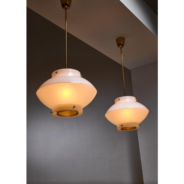 Stockmann Orno Pair of Yki Nummi White Plexiglass and Brass Pendants for Orno For Sale - Image 4 of 5