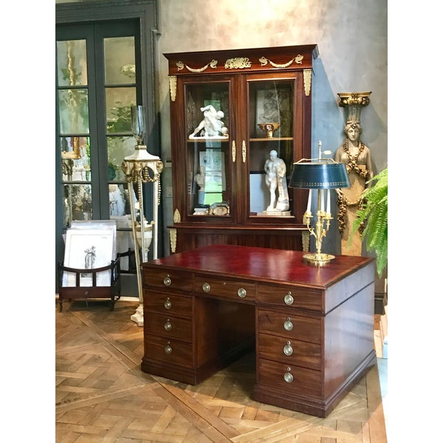 This beautiful George III period mahogany pedestal partners desk has a deep red leather top. It has 18 drawers in total....