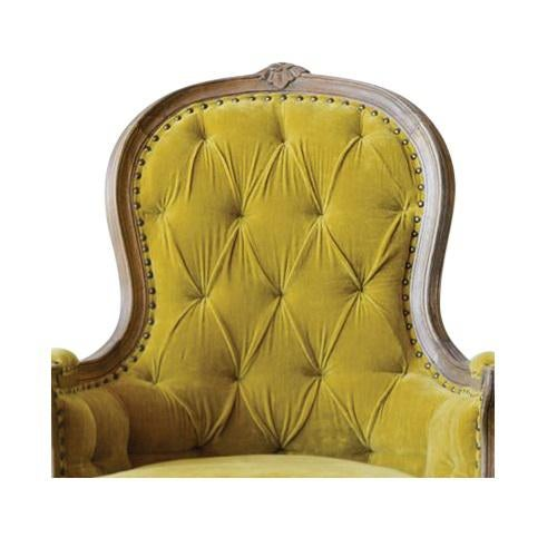 "A French style classic armchair made in mango wood with cotton velvet chartreuse colour. Carved detailing. Width: 28""..."