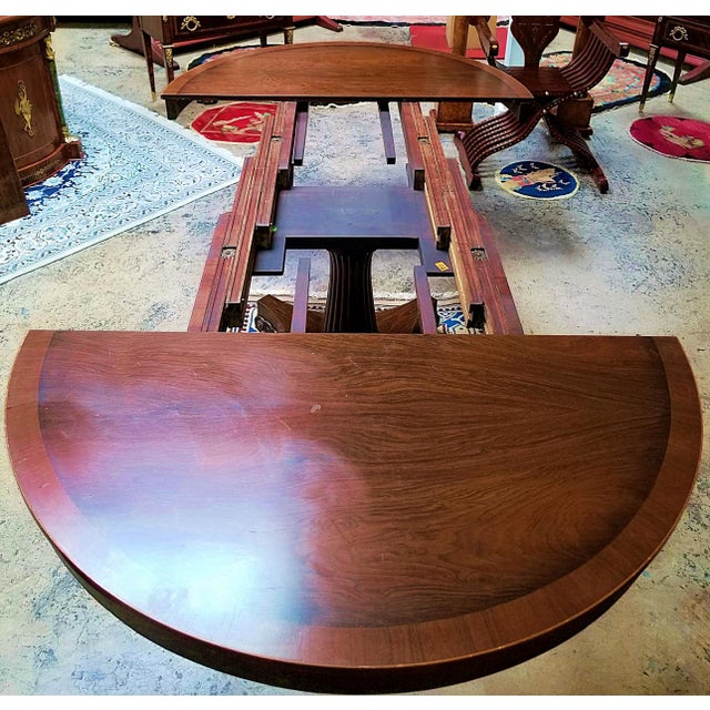 Presenting a beautiful late 19th century American mahogany extendable dining or center table. From circa 1890 this table...