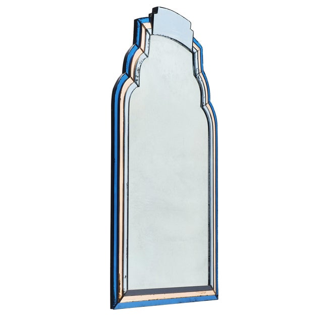 French vintage blue and pink mirror with beveled glass. Surrounding the central mirror is a frame of blue and copper pink...