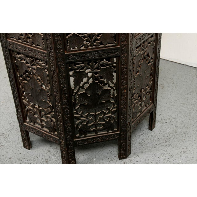A moroccan style octagonal occasional side table with an architectural bone inlaid medallion depicting flowering vines and...