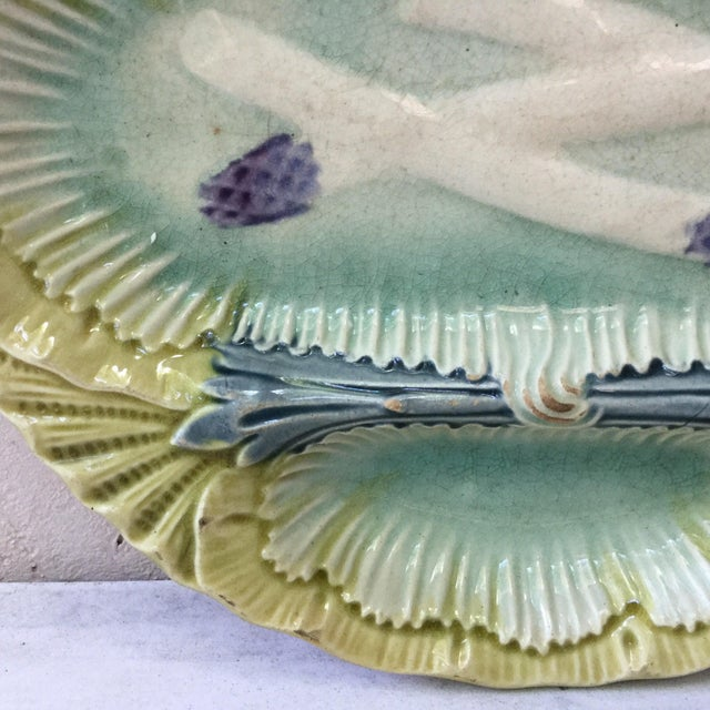 Unusual French Majolica asparagus plate with 3 spaces unsigned circa 1890.