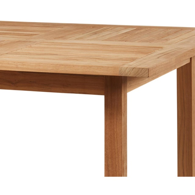 The Birmingham Square Teak Outdoor Dining Table is designed and hand-crafted from naturally aged teak wood. Featuring a...